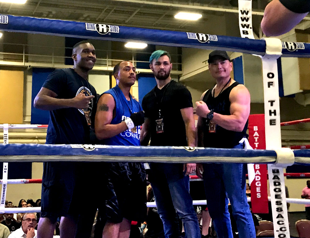 "Team VFC's  Sterling ""Money"" Ingram  poses with teammate/coach Marqus Blevins (Undefeated UCA Heavyweight and Super Cruiserweight Champion), teammate/coach Diamond Templeton (Pro-MMA Fighter), and coach D Womack (VFC Owner) following his win."