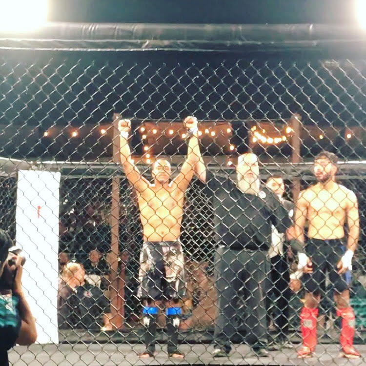 "Sterling ""Money"" Ingram  has his hands raised after winning his MMA debut via TKO"