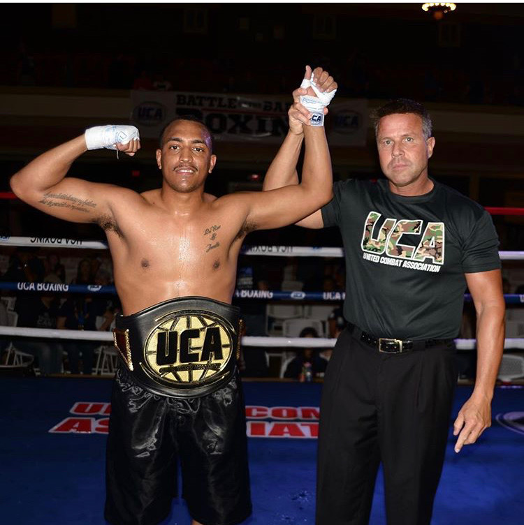 """Sterling """"Money"""" Ingram  has his hand raised after winning the UCA Super Middleweight Title"""