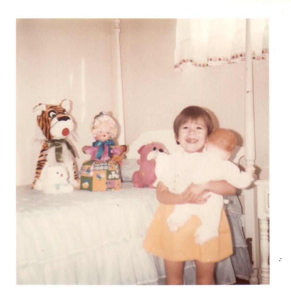 Me + my canopied bed + display of dolls & stuffed animals circa 1975