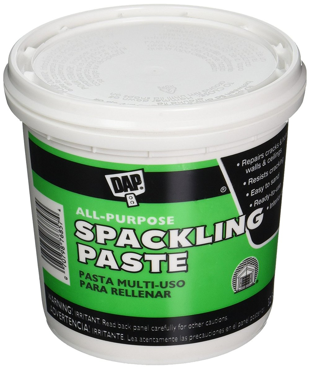 I use DAP All-Purpose Spackling Paste. It's inexpensive, sands easily, can generally be found in any hardware store and works well for my purposes. You can also find it on  Amazon .