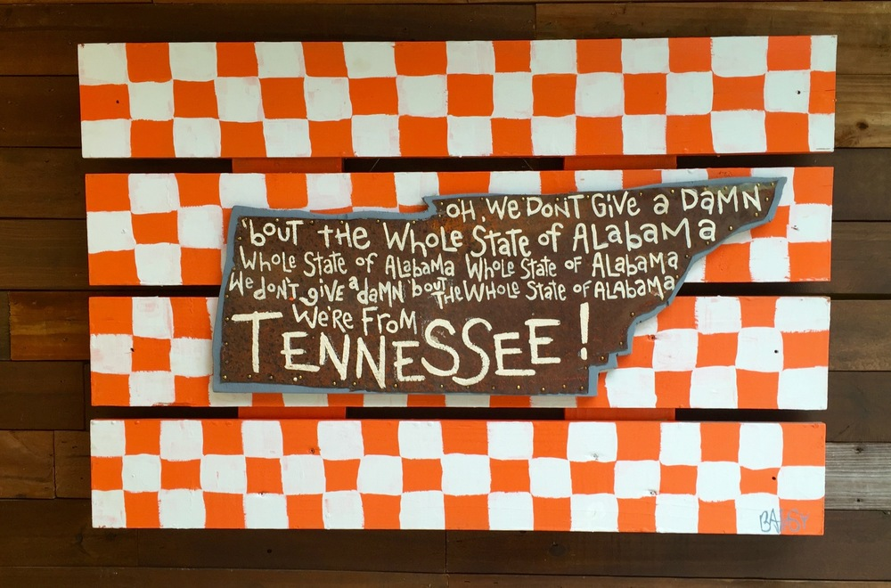 Vol Victory Song - My dad used to coach at UT & I loved hearing the team sing this song in the locker room, after victories.  I also love the fact that they haven't been able to sing it after beating my Florida Gators in quite a while.  ;)    mixed media - found shutters & found tin, paint & wood / 2' x 3' / 450