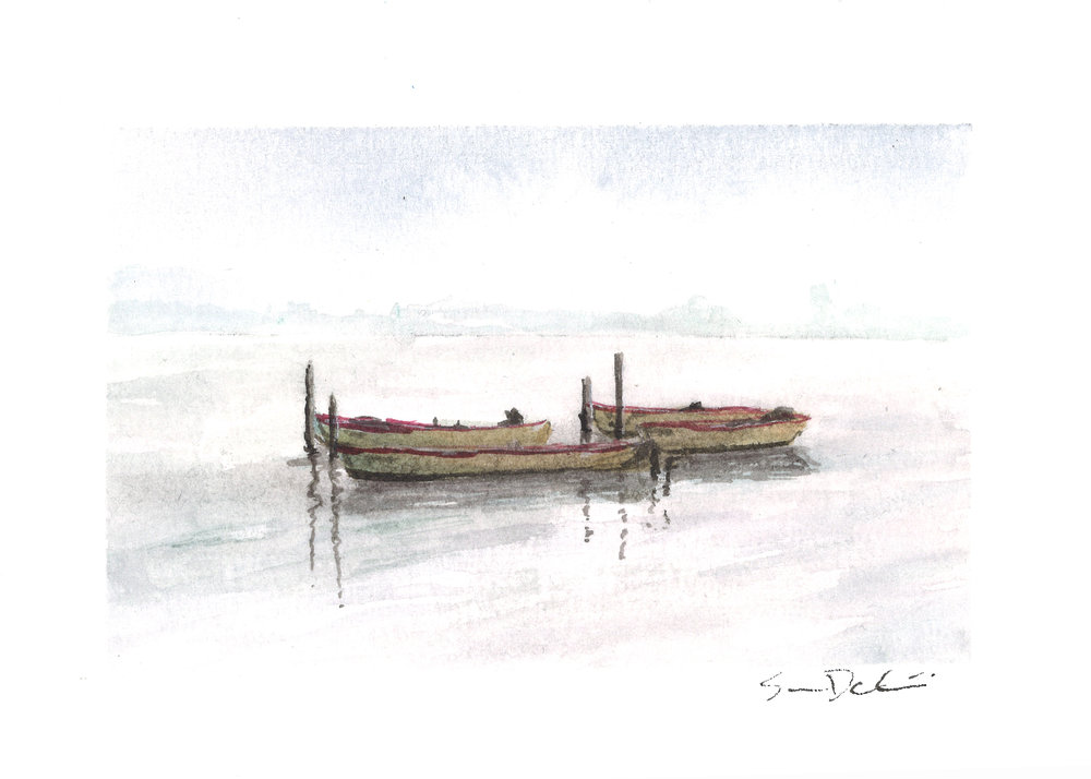 four boats in the fog