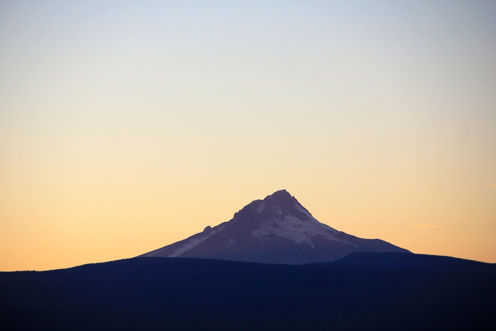 Mount Hood illuminated by the setting sun.