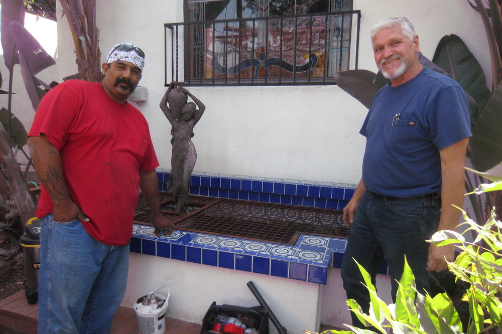 Julio and Willy standing proudly next to the finished grill