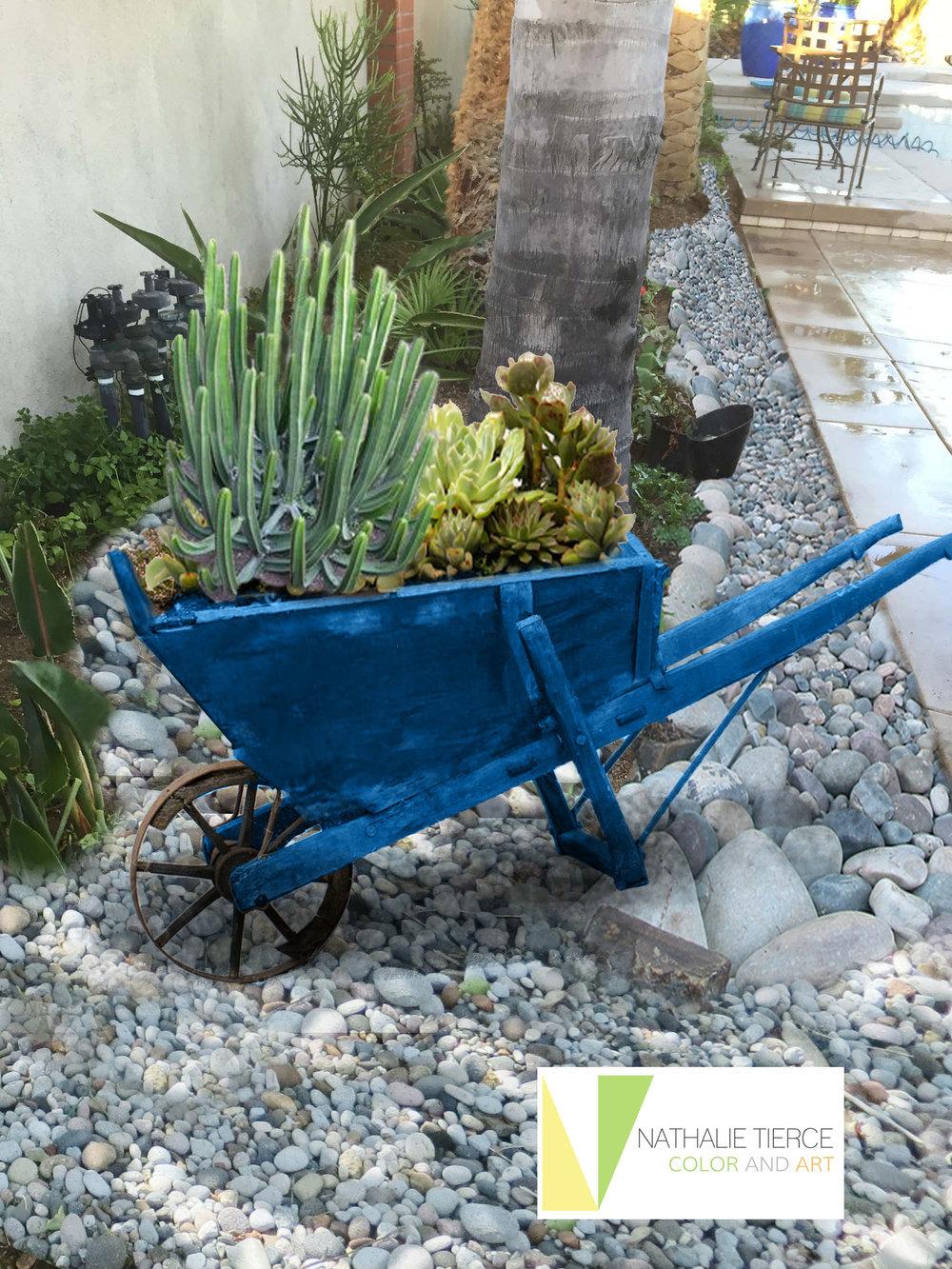 carol poolside wheelbarrow_b new logo.jpg