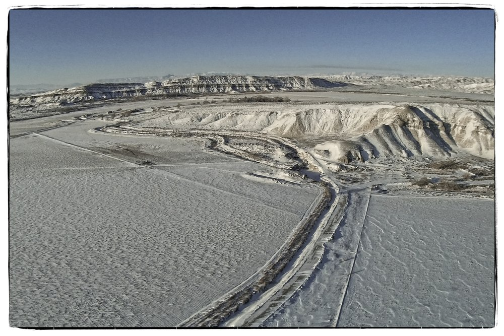 Syma X8C with a Mobius camera between Deaver and Powell, Wyoming on a sub-zero winter morning. Edited in On1 Photo 10 software.