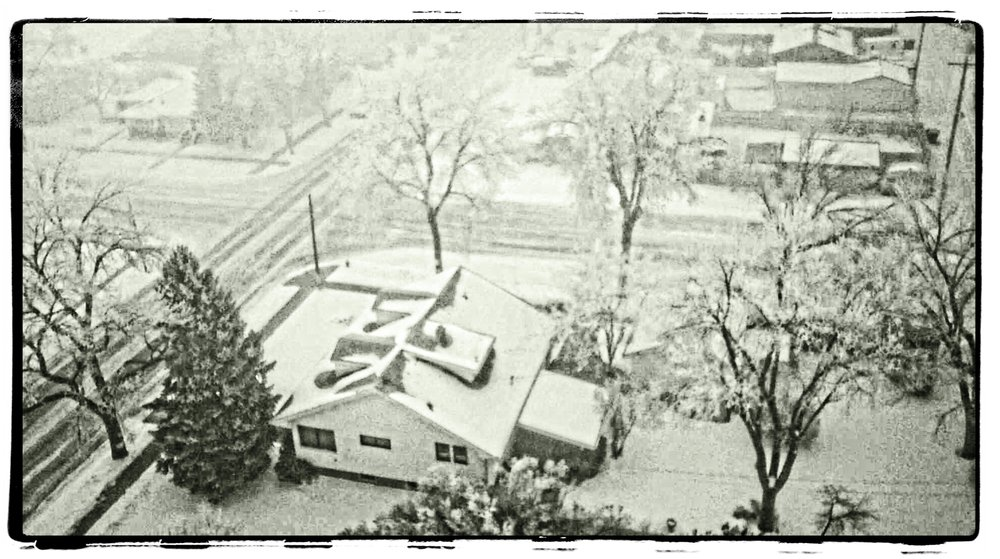 Looking down on one of the neighborhood houses with the H-12 during a snow storm.