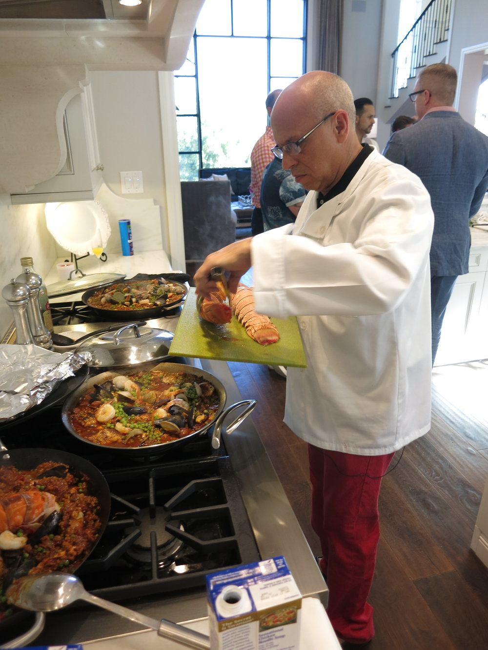 Cooking paella at a Candelaria Design open house.