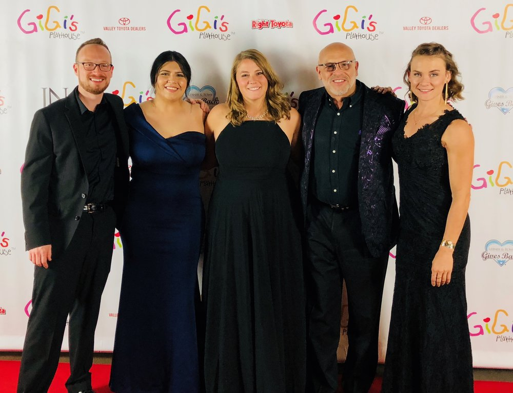 Damon Wake, Angeline Ponce, Nikka Bochniak, MC and Kim Schroeder at the Gigi's Gala