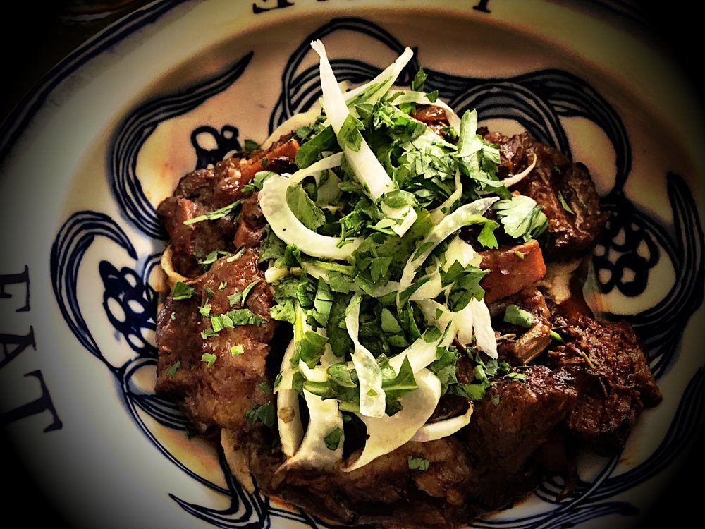 Hatch Red Chile Short Ribs with a Fennel and Arugula garnish