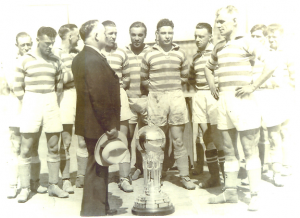 The Fall River Marksmen are presented with the Dewar Trophy after winning the 1931 National Challenge Cup