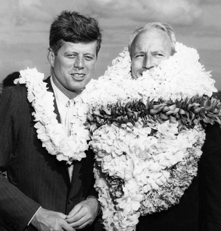 JFK and Hawai'i Governor John Burns with all his lei.  In Hawai'ian language the word lei refers to one lei or many lei!