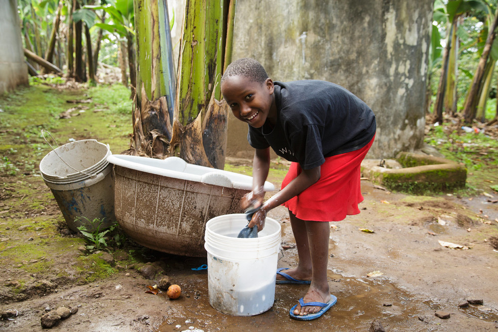 Delfina, one of the orphans at Good Hope Trust, doing her daily chores.