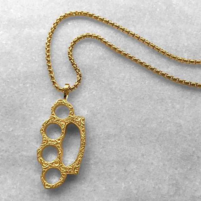 The knuckle brass pendant, equipped with our chunky chain - available online.