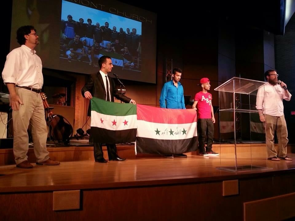 There's Saif, holding the Syrian flag and corner of the Iraqi flag with a couple of my other friends, Aws and Atheer. And the guy with the mic? That's me again with that rockin' beard!