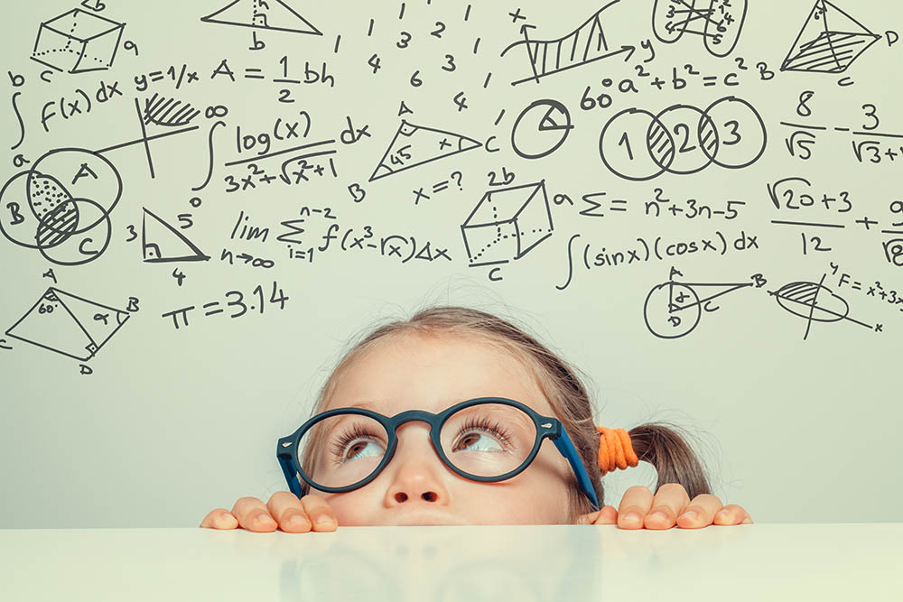 Image, young girl looking at complex equations