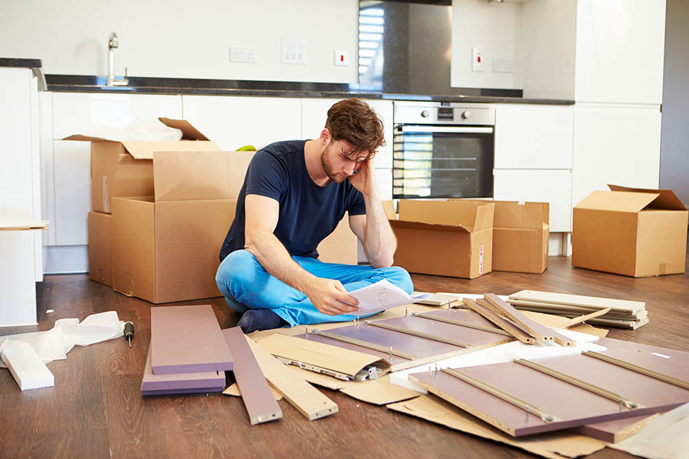 Image, man struggling with instructions