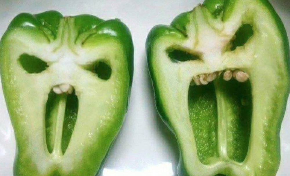 Image of peppers cut open to show random scary faces