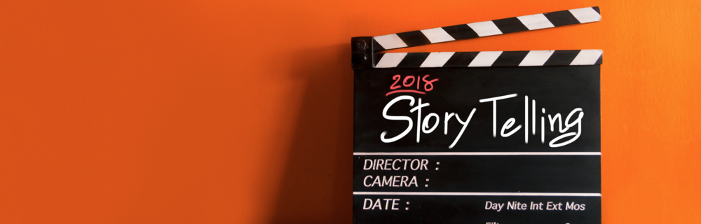 "Image of clapperboard with text reading ""Storytelling"""