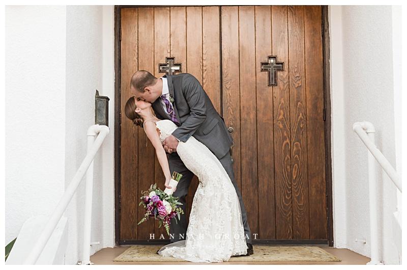 galveston chapel kiss wedding day bride and groom
