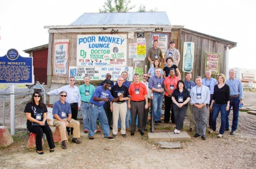 Participants in the recent Mississippi Development Authority tour of the Delta, outside Po' Monkey's Lounge in Merigold.