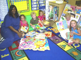Delta State Child Development Center: From left-right, Brenda Dumas, teacher, Samantha Blake, Sherrod Cauthen, Kate McClain, Cash Miller, and Elizabeth Gray Havens students in the four year-old class look over some of the donated books.