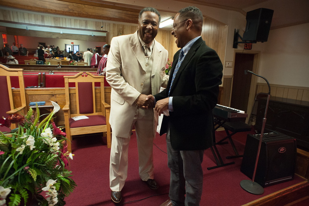 Dr. Rolando Herts, director of the Delta Center for Culture and Learning, greets the Rev. Nathaniel Pollard during church services at New Bethel Missionary Baptist Church in Clarksdale.