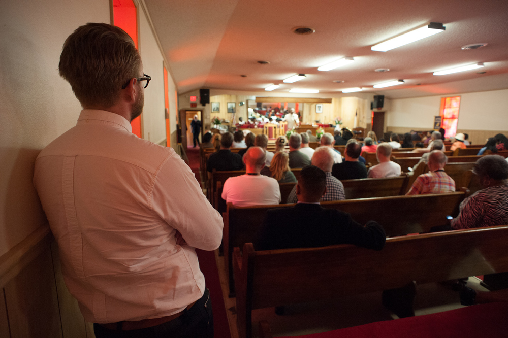 The group enjoys gospel music by the choir during church services at New Bethel Missionary Baptist Church in Clarksdale.