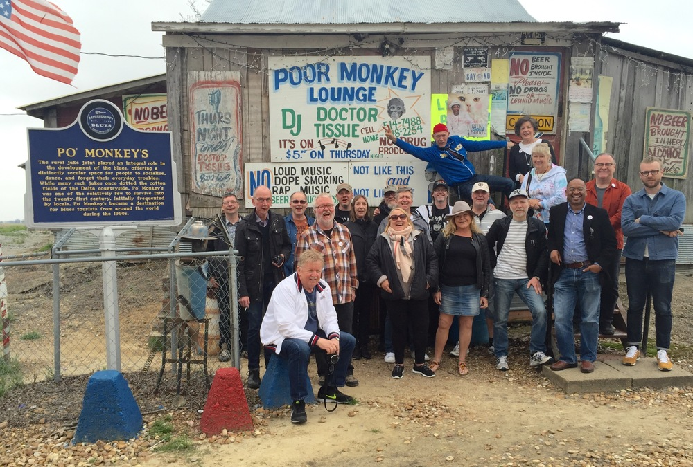 The group poses outside of Willie Seaberry's legendary juke joint, Po' Monkey's Lounge.