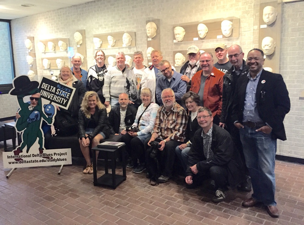 The Swedish music enthusiasts gather for a group photo with the Delta State Blues Okra after viewing the Cast of Blues exhibit at The Delta Center.