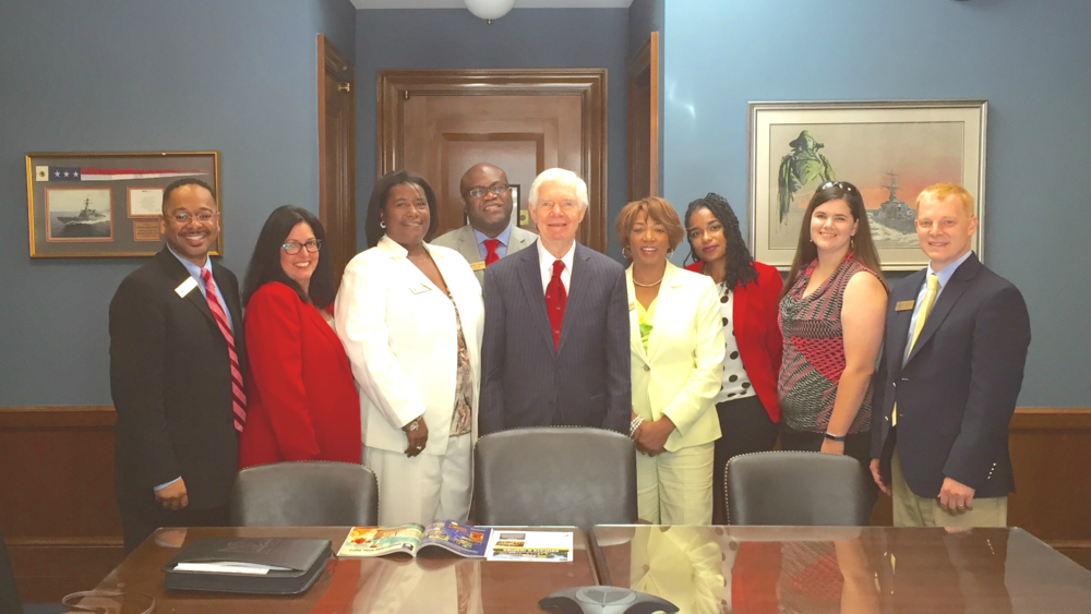 Participants pose with Senator Thad Cochran