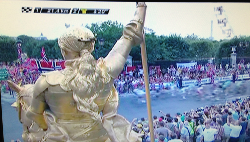 Golden statue of Joan of Arc greets the riders in Le Tour de France 2013