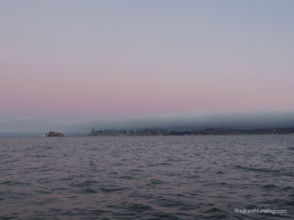 Layers of pink above the fog over San Francisco at sunset.