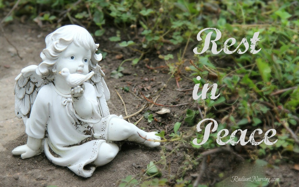 Rest in Peace. A cherub in the garden and cemetery.