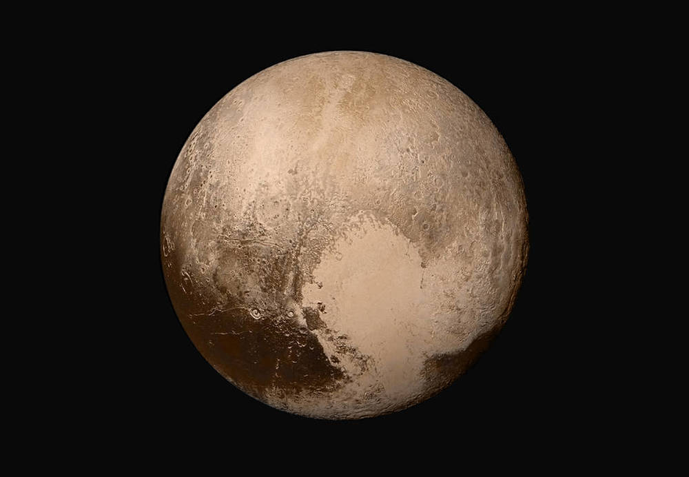 Say hello to Pluto! Our first photos from a spacecraft zooming past the tiniest planet in our solar system.