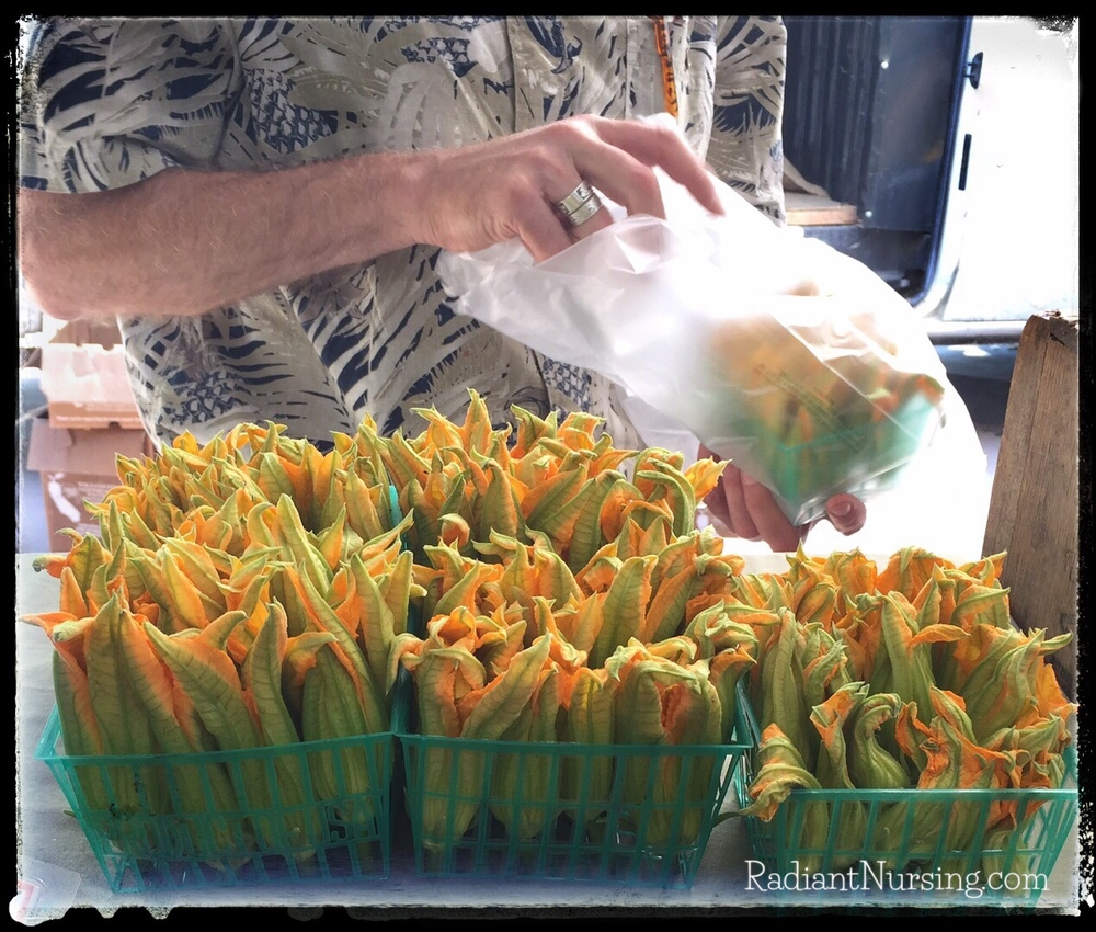 You can try different foods at the farmers market. Here are squash blossoms.