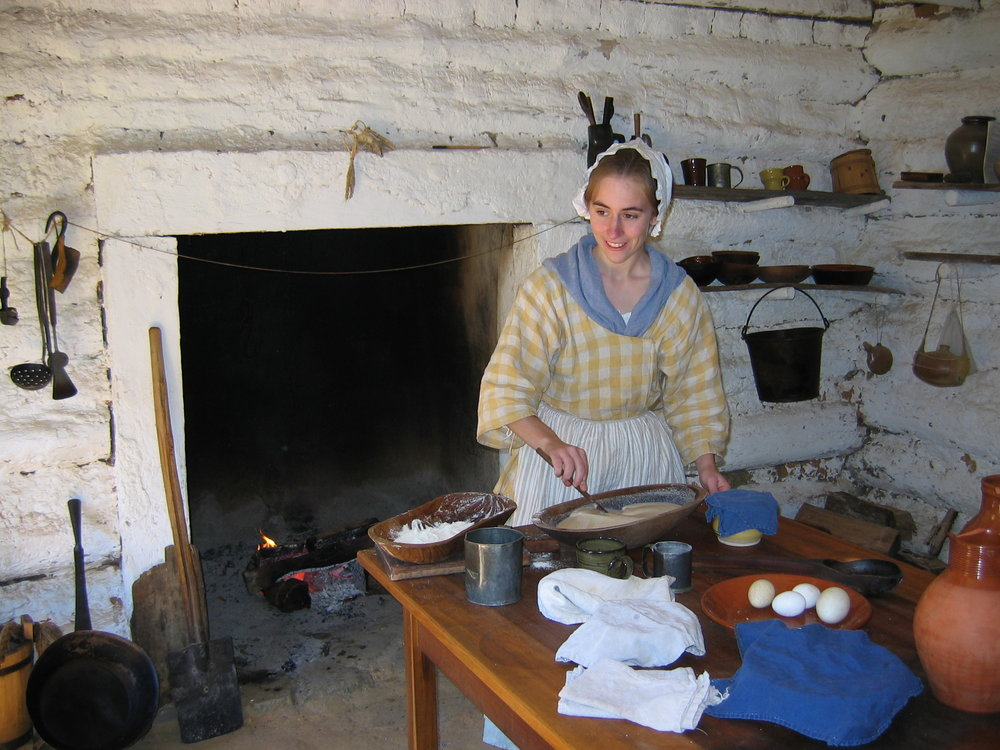 Cooking in an old-fashioned kitchen many years ago.