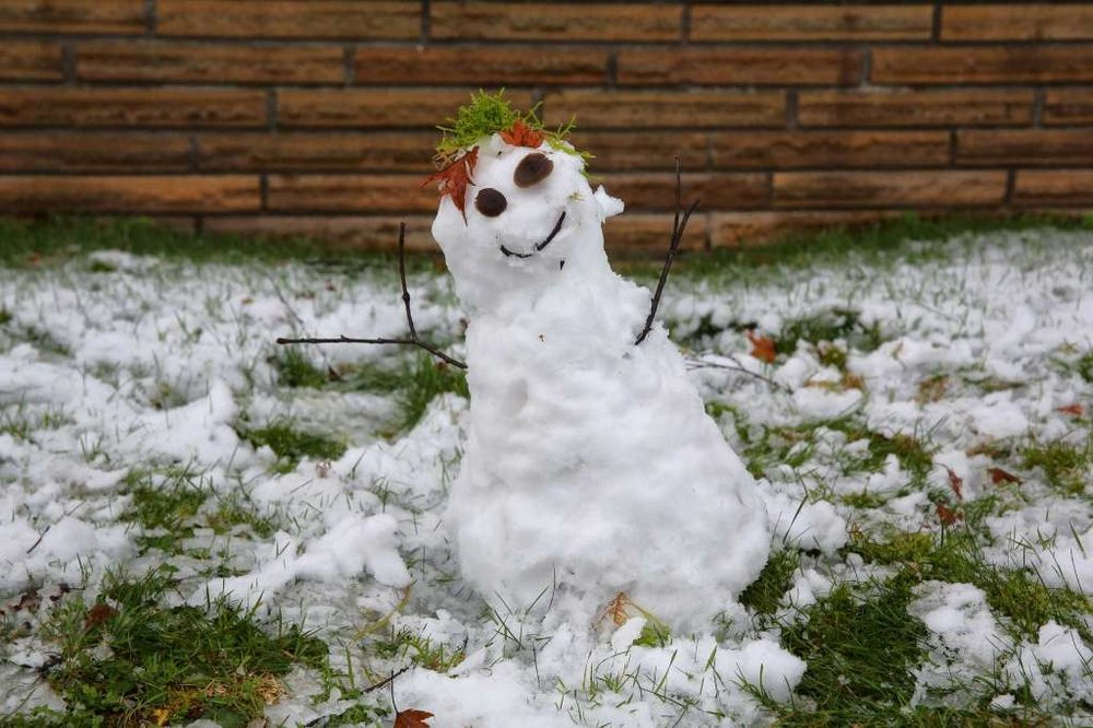 Melting snowman. We dream of the next snowfall when the snowman can visit again.