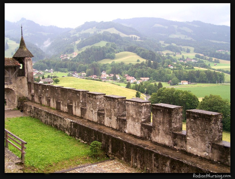 The ramparts of a castle, looking out over the valley.