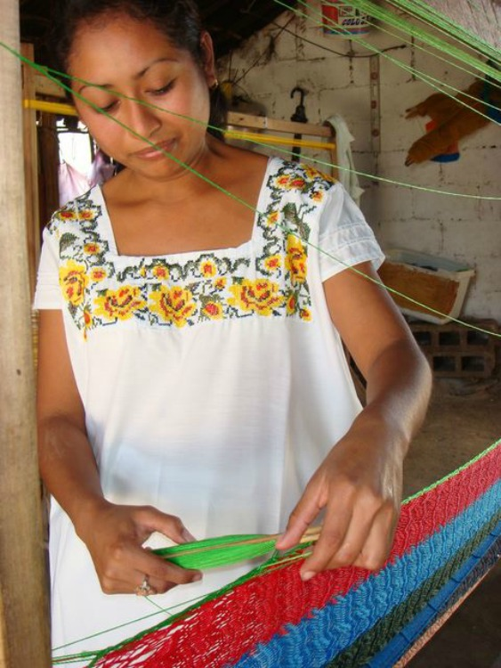 A woman weaves a Mayan hammock by hand in Yucatán, Mexico.