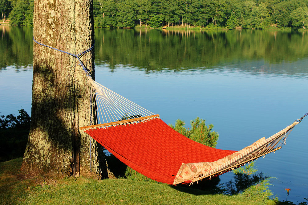 You can relax in a hammock by the lake.