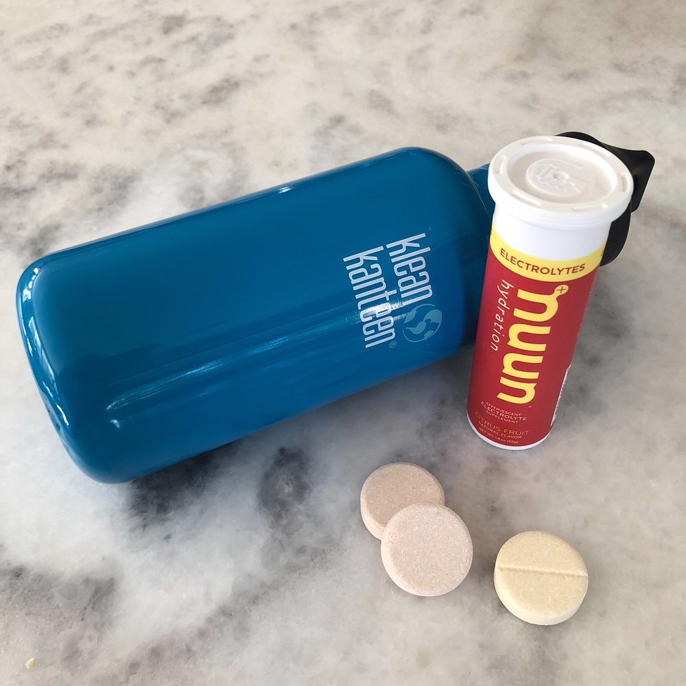 When traveling, bring along a 16 ounce Klean Kanteen water bottle, then pop in a Nuun tab for rehydration and electrolyte balance.