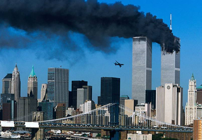 A plane heads toward one of the Twin Towers in New York City on 9/11.