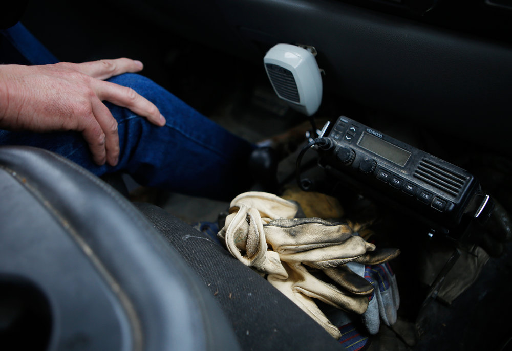 Heading southbound on Highway 63 in Boone County, a pair of work gloves rests near the center console of James's pickup truck. He often spends an entire day, from before sunrise to past sundown, working out of his truck. Due to the nature of his job, his truck functions as much like an office as his actual cubicle at the MDC headquarters on Gans Road.