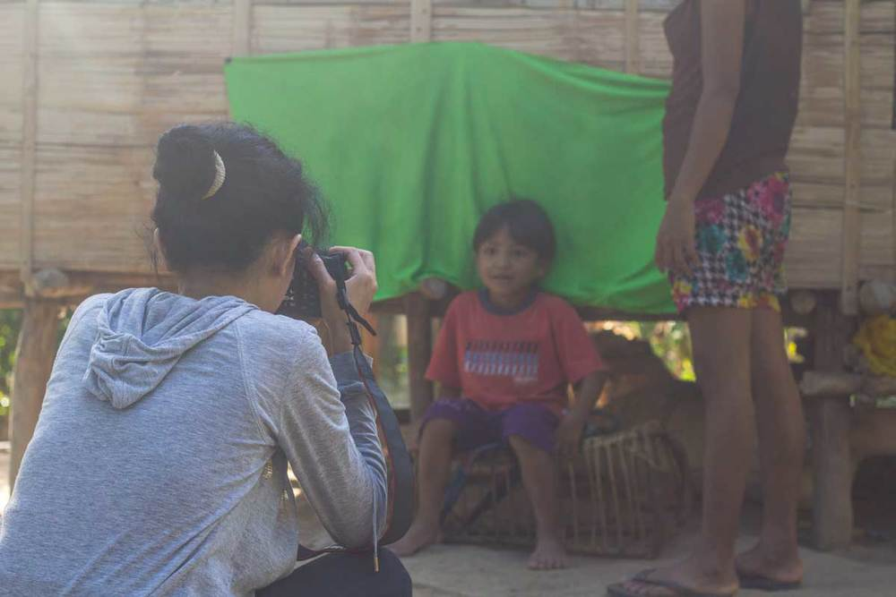 A boy from the Batak tribe getting his ID picture taken.