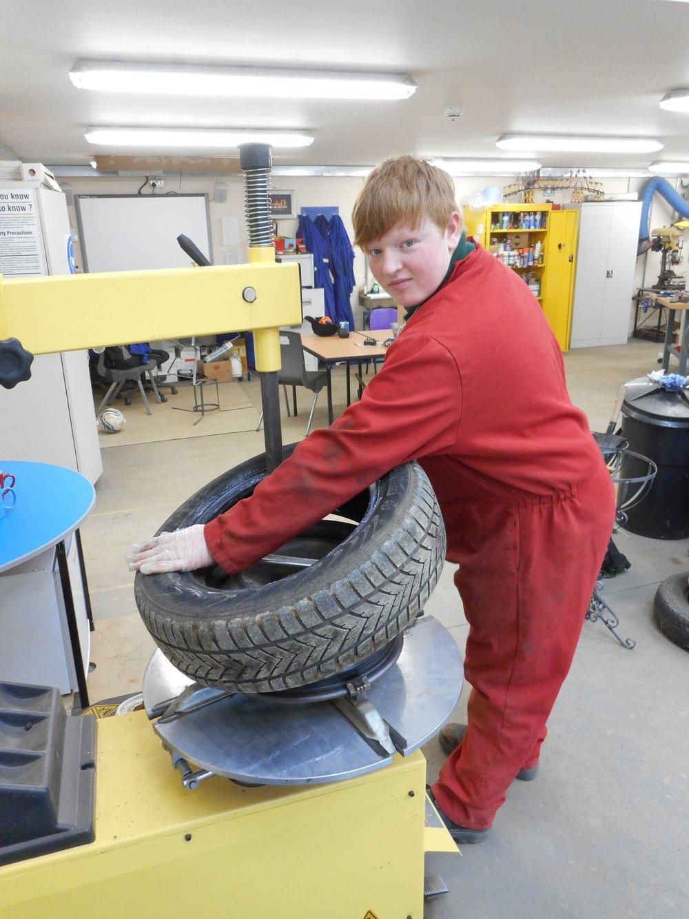 Brendan fitting a tyre