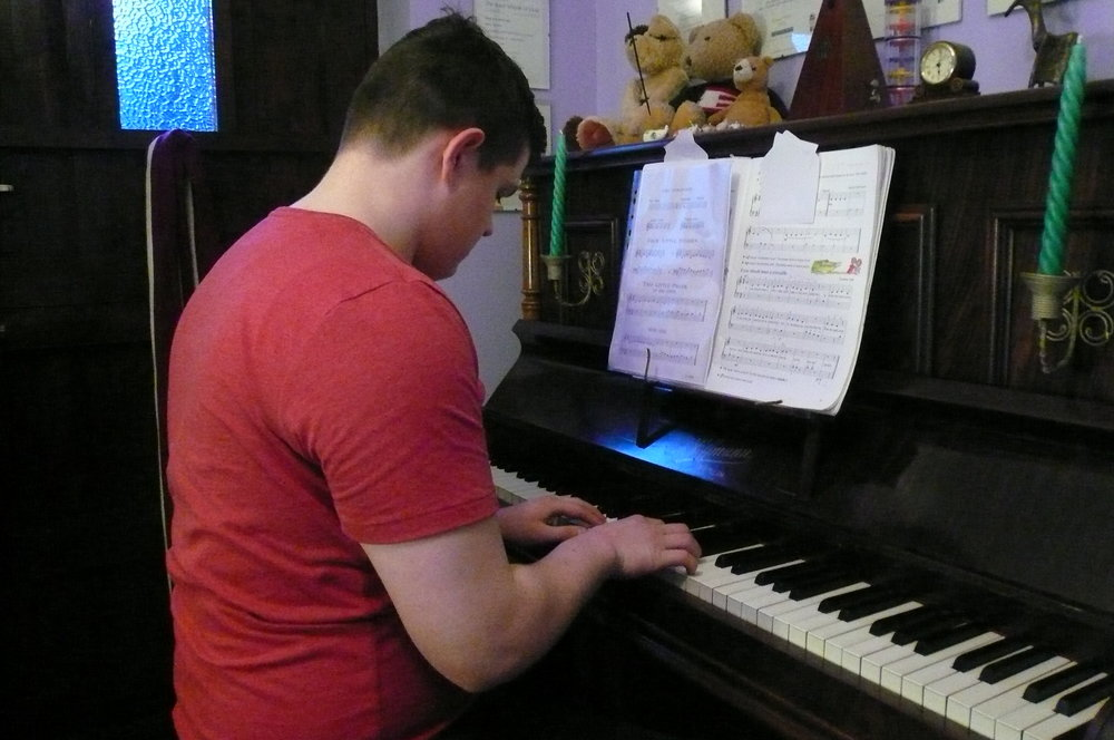 Oliver playing piano