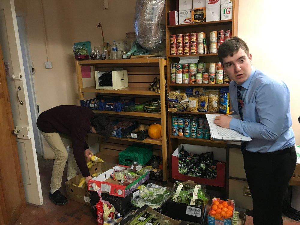 Organising the food at the food bank.