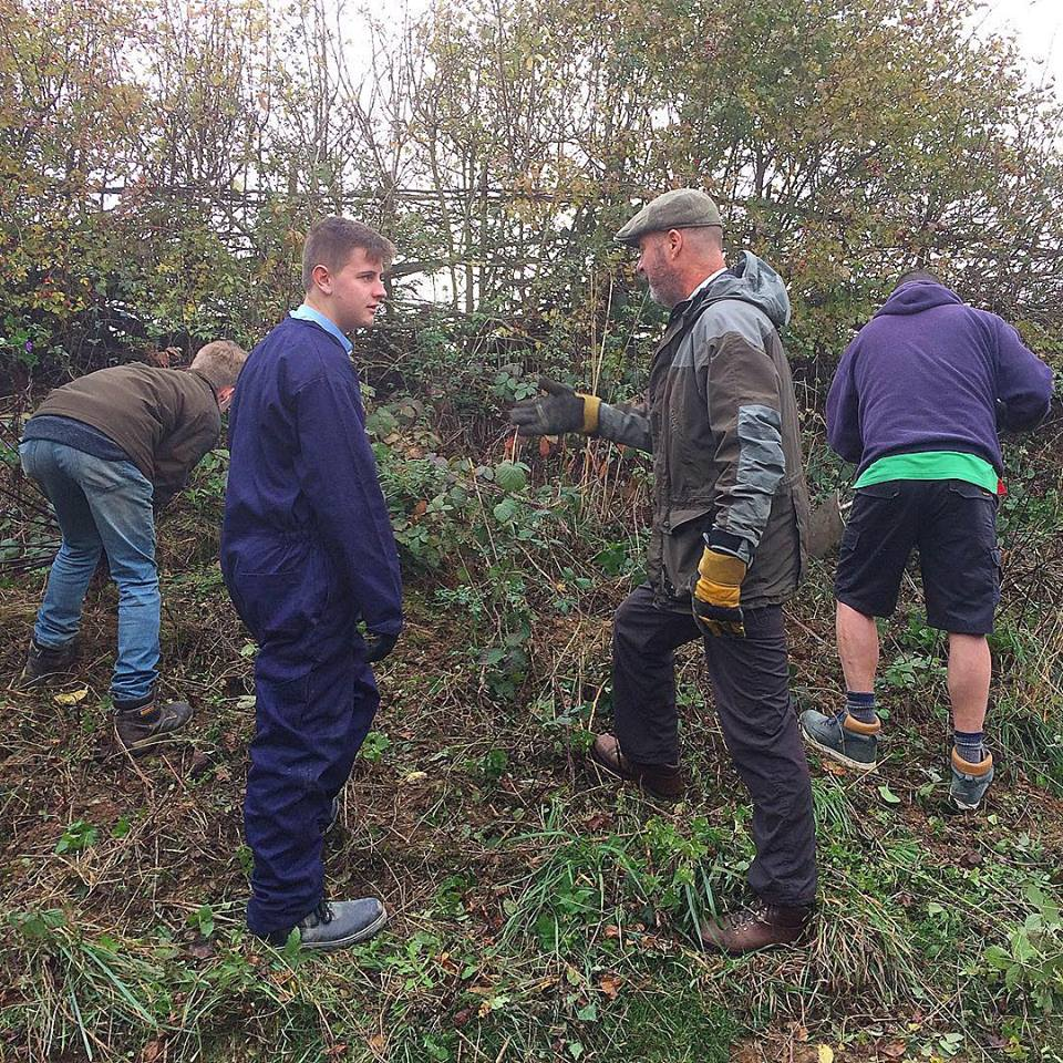 Community Work clearing a garden.
